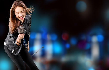 Female Rockstar Singing With Retro Vintage Microphone