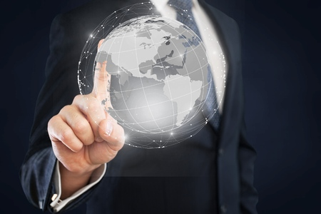 Businessman drawing earth on background