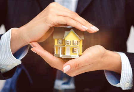 Businessman Holding House Model and Keys, Real Stock Photo