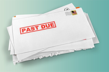 Pile of envelopes with overdue utility bills Stock Photo
