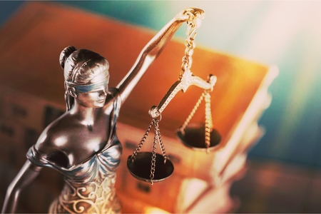 Justice Scales and books and wooden gavel Stock Photo
