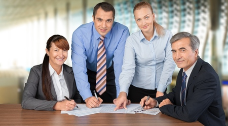 Business people making report at table with Stock Photo