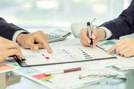 Businesspeople Doing Calculations , close-up view