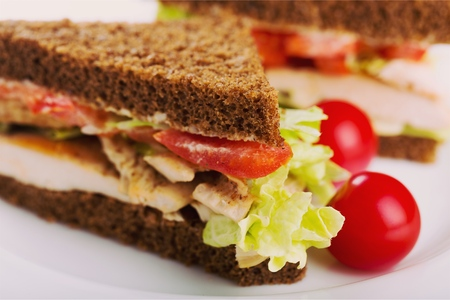 Sandwich with ham and vegetables on wooden
