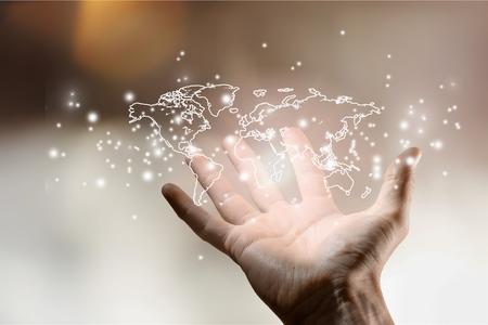 Hand holding glowing digital world map