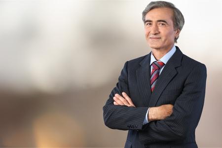 Senior business man in grey suit