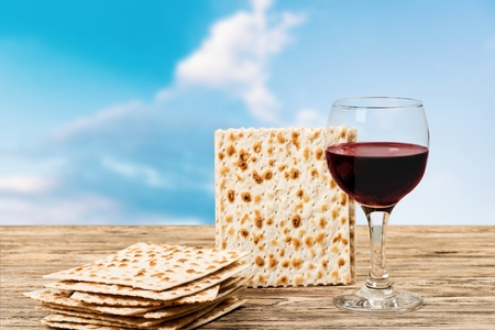 Passover background. wine and matzoh over wooden