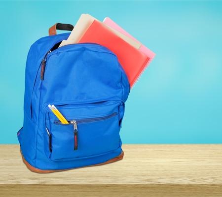 Open blue school backpack and school desk Stok Fotoğraf