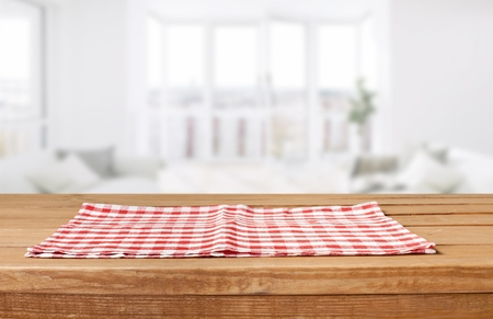 Red cloth napkin on wooden background Imagens - 114001600