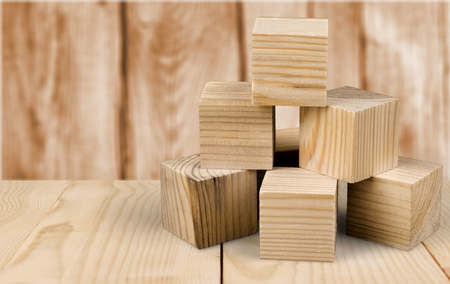 Wooden cubes on table background Stockfoto