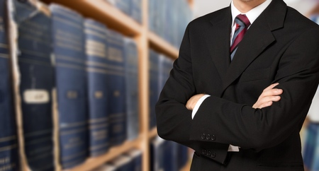 Man lawyer in library on shelves with