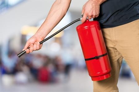 Hand presses the trigger fire extinguisher hand Banco de Imagens