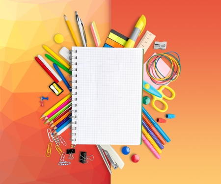 Blank Notepad among the School Supplies Isolated
