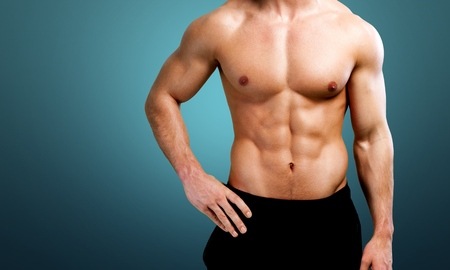Cropped image of fit muscular body of sportsman Stock Photo