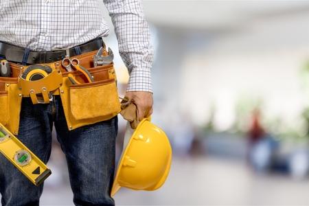 Werknemer in een bouwplaats Stockfoto