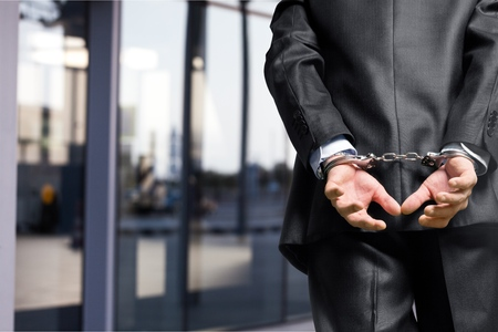 Cropped image of male hands in handcuffs Standard-Bild - 124674007