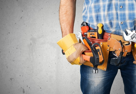 Worker with a tool belt Stock Photo