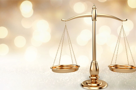 Law scales on table background. Symbol of justice Reklamní fotografie