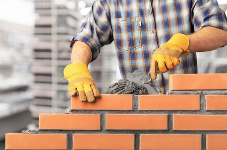 Bricklayer cement masonry build layer house worker Stockfoto