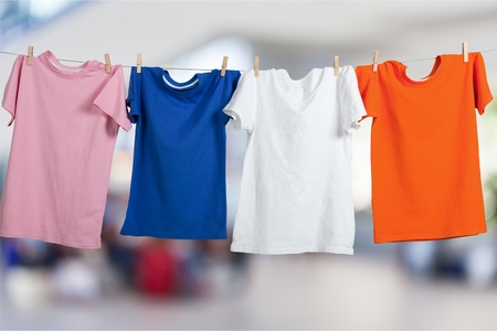 Wash clothes on a rope with clothespins Standard-Bild