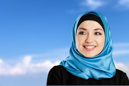 Young arabian woman on light background