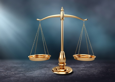 Law scales on table background. Symbol of justice Stock Photo