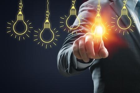 Businessman pressing light creative  idea .Concept  idea and innovation          - Image Imagens - 124596823
