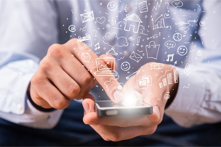 Hands holding smartphone on background