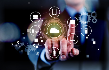 Businessman and internet and virtual reality concept - businessman pressing button on virtual screens