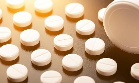Pill and tube adderall lsd oxycontin valium arranged black