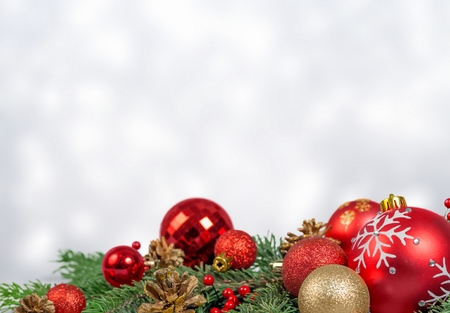 Christmas decorations with tree branches and baubles