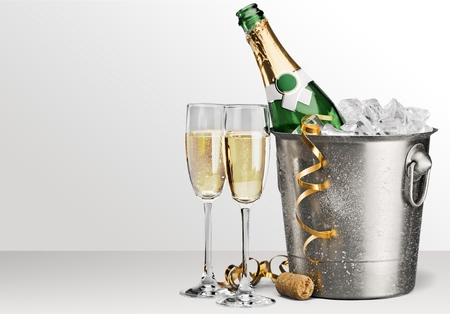 Two glasses of champagne and bottle