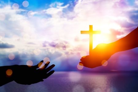 Jesus helping hand concept: World Peace Day Help hand on sunset background          - Image