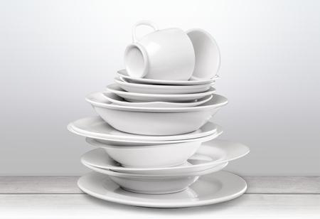 Pile of White Dishware isolated on white