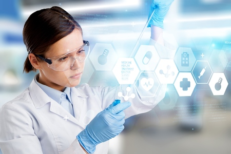 Young Asian scientist with test tube making research in clinical laboratory.Science, chemistry, technology, biology and people concept Stock Photo