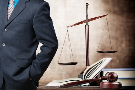 Successful lawyer with book and judge gavel