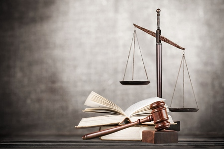 Law scales on table background. Symbol of Stock Photo