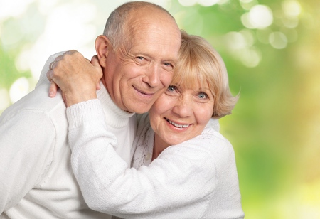 Portrait of happy senior couple smiling at