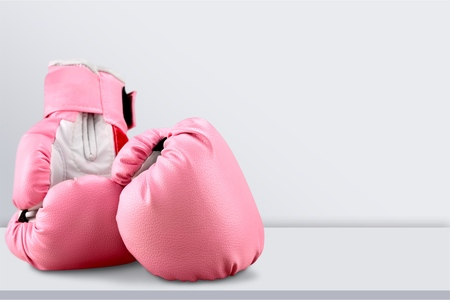 Pink boxing gloves on background Banco de Imagens