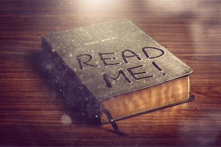 Holy Bible book with read me letters