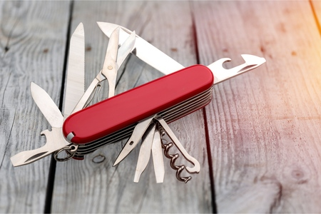 Multi-Tasking metal Penknife isolated on white Фото со стока