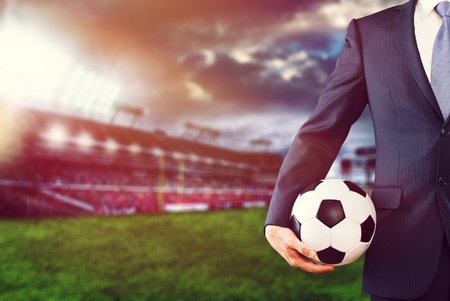 soccer manager holding football in the stadium Stok Fotoğraf