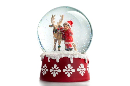 Snow globe with a child and a reindeer Stockfoto