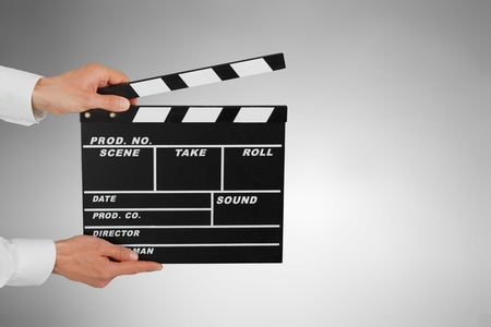 Two Hand's holding Clapperboard or movie slate use in video production ,film, cinema industry on black background.          - Image Stockfoto