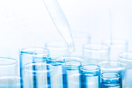 Science laboratory test tube and pipet with drop, laboratory equipment closeup Stock Photo