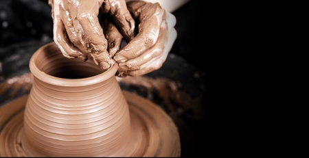 Hands of potter making clay pot 免版税图像