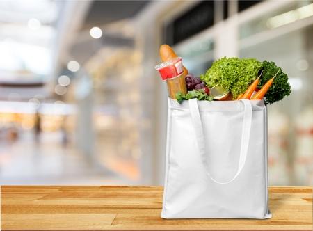 Full shopping bag, isolated over background Reklamní fotografie