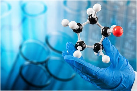 Scientist man  holding molecule form isolated on background,close up