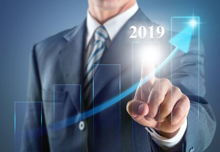 Business development to success in 2019 concept. Businessman pointing arrow graph corporate future growth plan Stok Fotoğraf