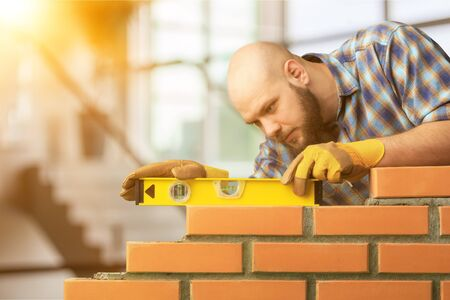 Maurerzementmauerwerk bauen Schichthausarbeiter Standard-Bild